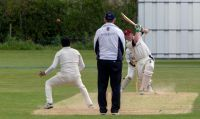 Mark-Usher-lifts-one-over-the-off